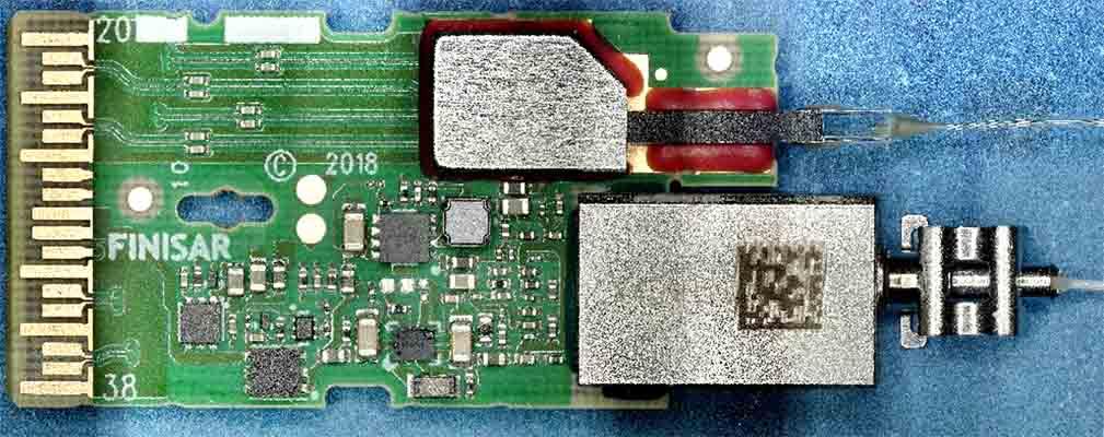 Finisar 100G CWDM4 Transceiver FTLC1157RGPL - Finisar FTLC1157RGPL-TE Board - Optical top View – main principal - System Plus Consulting